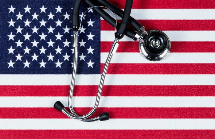 United States of America flag with stethoscope. Medicare for all, socialized medicine, single payer and healthcare reform.