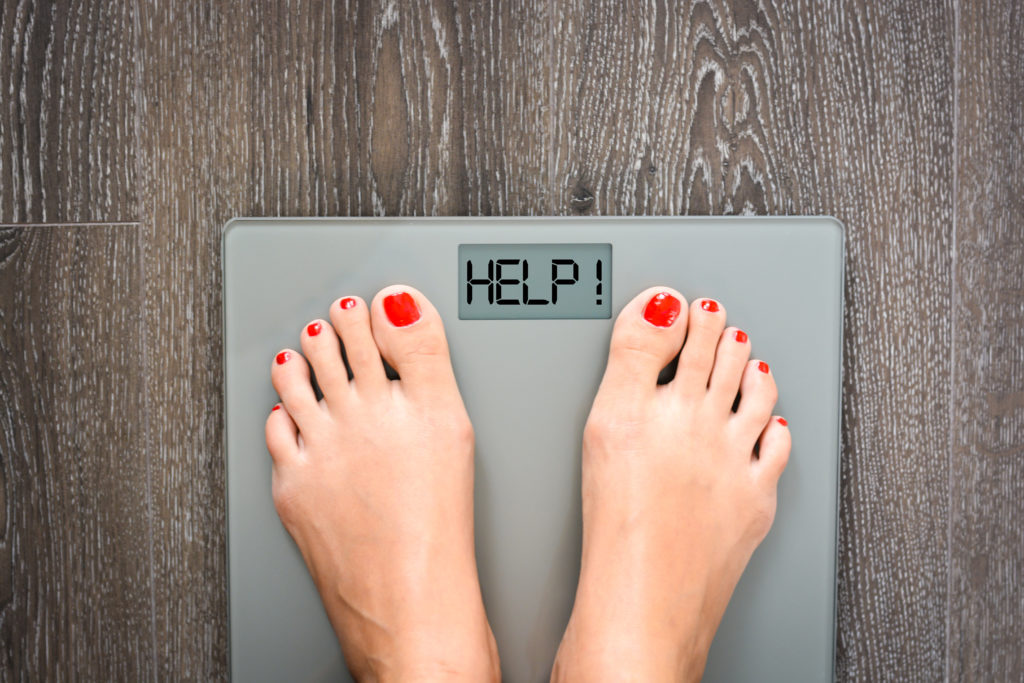Lose weight concept with person on a scale measuring kilograms